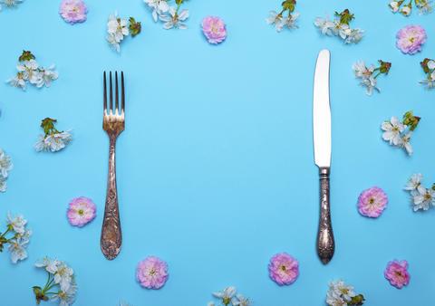 vintage fork and knife on a blue background Fotografía