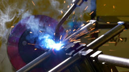 Metal iron laser argon welding robot in factory slow motion Footage