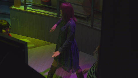 Plastic Girl expressively dances in a nightclub Footage