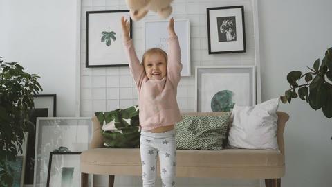 Little girl throws up plush rabbit ビデオ