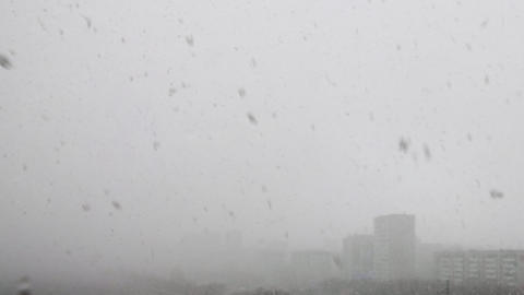 Cityscape with snowfall in cold winter, aerial panoramic view ビデオ