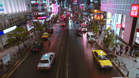 Traffic passes under a bridge outside Shinjuku station Footage