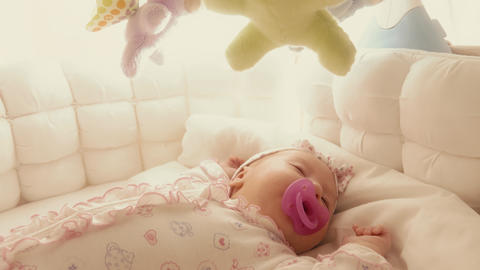 Cute baby girl sleeping in her cot Footage