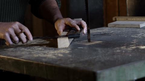 Carpenter measures and marks cutting line using a carpenter's ruler Live Action