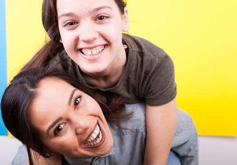 Two happy sisters laughing Photo