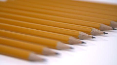 Pencils on white background close-up GIF
