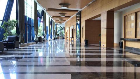 through empty hotel corridor GIF