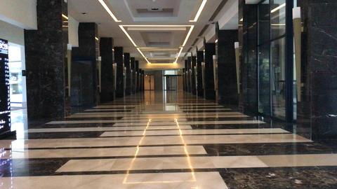 through empty hotel corridor Live Action
