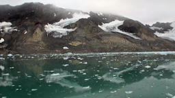 Moving Ice Floes on background of mountain on water of Arctic Ocean in Svalbard Footage