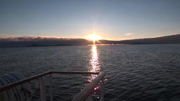Back of the ship in water on background sunset on the horizon in Svalbard Footage