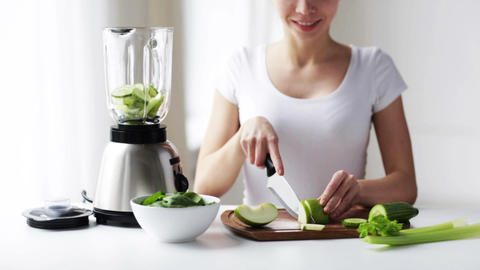 smiling woman with blender chopping vegetables Footage