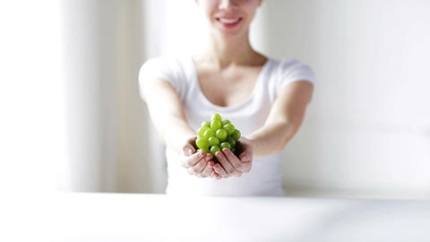 Close Up Of Young Woman Showing Green Grape Bunch stock footage