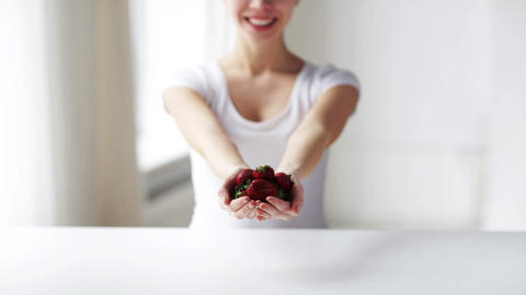close up of young woman showing strawberries Footage