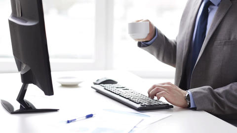 close up of businessman typing and drinking coffee Footage