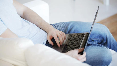 close up of man typing on laptop at home Footage