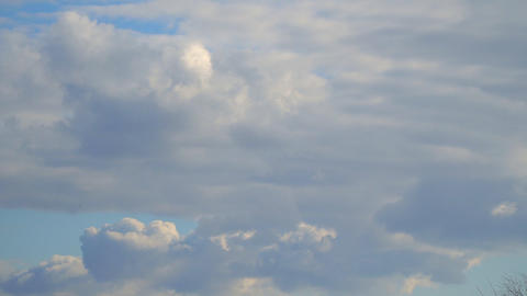 Clouds move across the blue sky Footage
