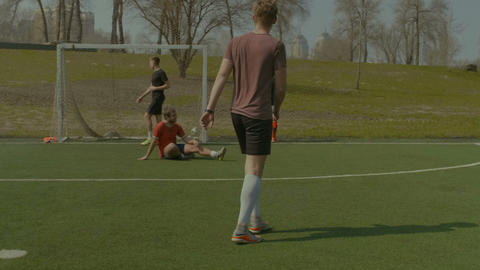 Football player tackling for ball against striker Footage