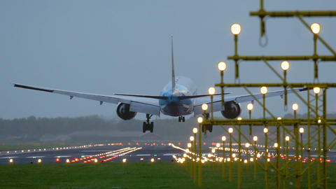 Airplane of KLM airlines approaching behind landing lights Footage