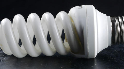 close-up of energy saving compact fluorescent light bulb Footage