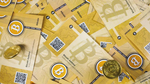 Coins Fall on Souvenirs of Bitcoin Payment System Footage