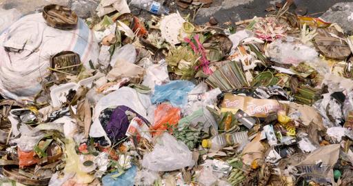 BALI, INDONESIA - CIRCA JAN 2018 - Close up of trash dumped next to a river Image