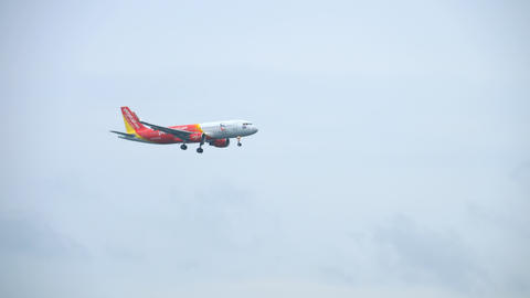 VietJet Airbus A320 approaching over ocean Live Action