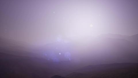 4K .Aerial. Flight in mountains like bird through fog Archivo
