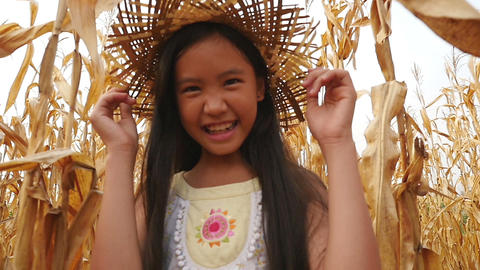 Happy Asian girl running in corn field, Slow motion shot Footage