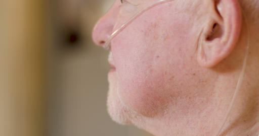 Closeup profile of an elderly senior man in his 70s or 80s wearing a Footage