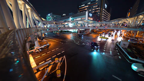 Traffic passes through a busy intersection in Osaka Footage