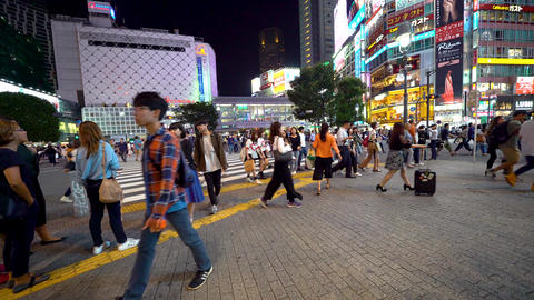 People cross the famous intersection in Shibuya, Tokyo, Japan Footage