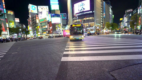 Traffic crosses the famous intersection in Shibuya, Tokyo, Japan Footage