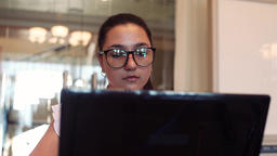 Business woman in glasses with dark hair running using computer and mobile phone Footage