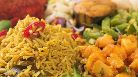 Indian biryani rice on banana leaf Footage