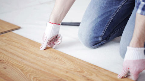 close up of man installing wood flooring Footage