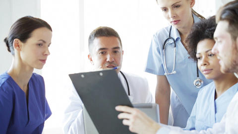 group of doctors with clipboard talking at clinic Footage