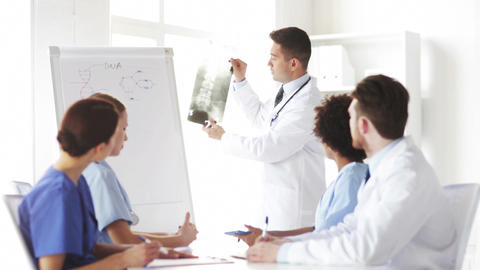 group of doctors looking at x-ray in hospital Footage