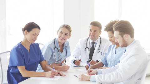 group of doctors meeting at seminar in hospital Live Action