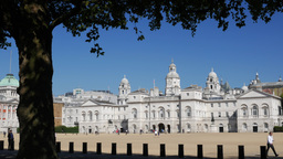 Cars pass in front of Horse Guards Parade and Whitehall in Central London. Shot  Footage