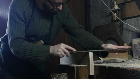 carpenter file a piece of wood with wood file Footage
