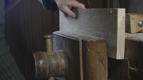 close up, carpenter squeezes a wooden board in a wooden vice フォト