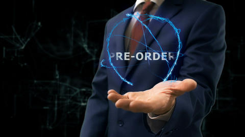 Businessman shows concept hologram Pre order on his hand Live Action