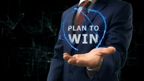 Businessman shows concept hologram Plan to win on his hand Footage