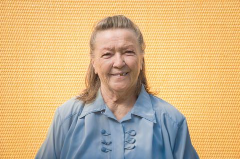 portrait of old elegant grandmother. caucasian positive, friendly granny smiling フォト