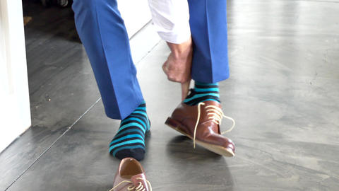 shot of wedding suits, tie, socks, shoes for the groom &… Stock Video Footage