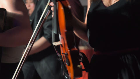 Woman dances while holding a violin Footage
