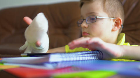 Cute child with broken hand can't make his homework Footage