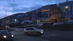 Night view of building of entertainment complex, cars driving on city road Footage
