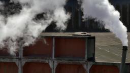 Smokestacks of factory tubes chimney smoke Footage