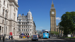 Static Shot Of Big Ben Taken From Parliament Square As Traffic Drives Past. Take stock footage